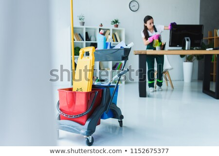 Female Janitor Cleaning Computer In Office Stock photo © AndreyPopov