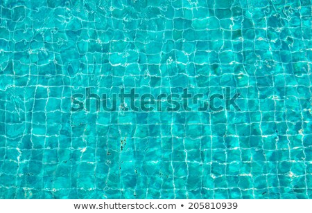 Swimming pool bottom caustics ripple and flow with waves background. Seamless blue ripples pattern.  Stock photo © olehsvetiukha