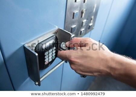 Main ascenseur télécommande homme Photo stock © AndreyPopov