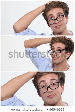 young man with his glasses askew and hand to his head Stock photo © photography33