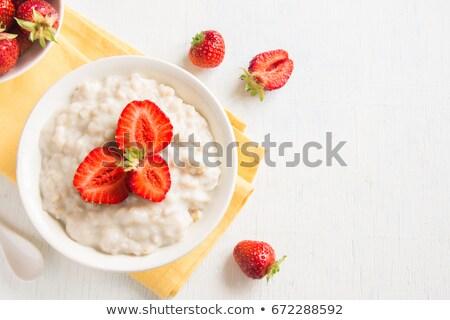 fresh strawberries in porridge stock photo © shutswis