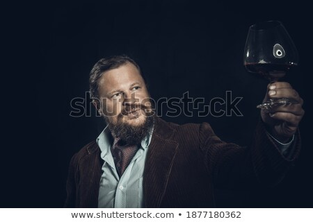 ストックフォト: Portrait Of Thoughtful Business Man With Glass Wine