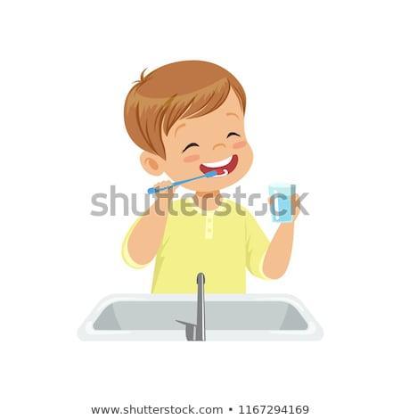 Fiú fogmosás férfi boldog fürdőszoba fogak Stock fotó © balasoiu