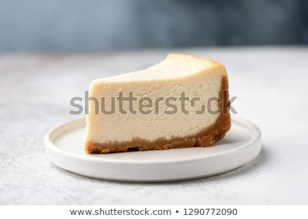 Cheesecake plaka parça meyve beyaz Stok fotoğraf © OleksandrO