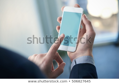 Businessman hold smartphone stock photo © hin255