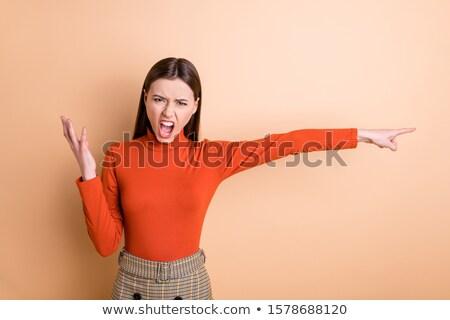 businesswoman poing finger away stock photo © deandrobot