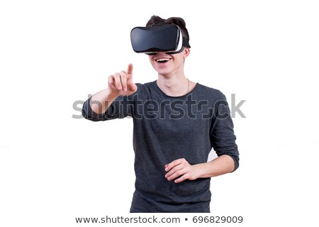 scared bearded young man wearing virtual reality device stock photo © deandrobot