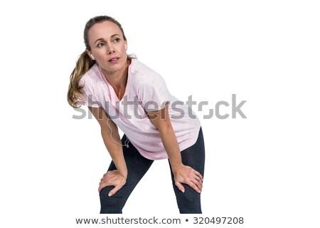 Thoughtful tired sporty woman bending Stock photo © wavebreak_media