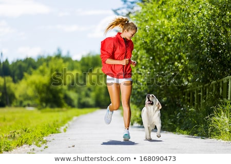 Woman runner walking with dog in summer park Stock photo © blasbike