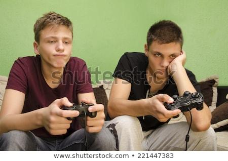 скучно · играет · Видеоигры · компьютер · сидят · таблице - Сток-фото © deandrobot