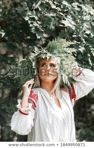 A young woman walks among the ferns Photo stock © galitskaya