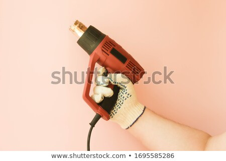 construction tool, hairdryer in male hand Stock photo © OleksandrO