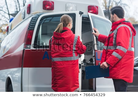 paramedic, closing the door of the ambulance. Stock photo © Lopolo