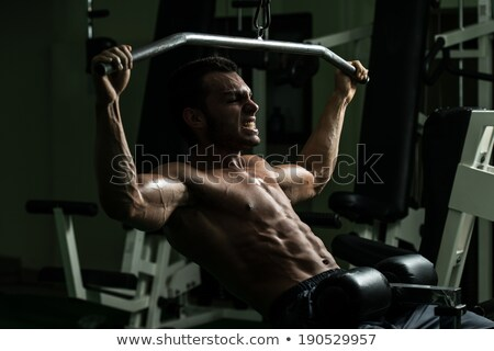 Muscular Men Doing Heavy Weight Exercise For Biceps Stock photo © Jasminko