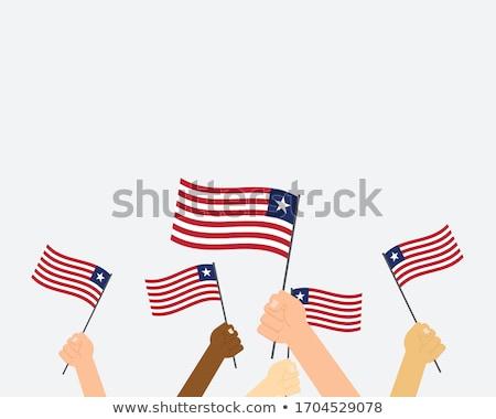 Libéria bandeira mão branco fundo África Foto stock © butenkow