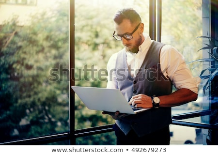 Young handsome male in waistcoat Stock photo © Elmiko