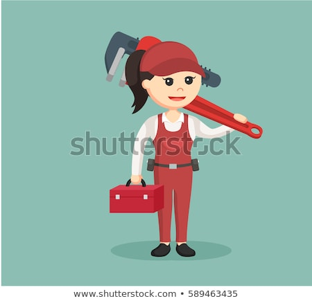 Tradeswoman holding a pipe wrench Stock photo © photography33