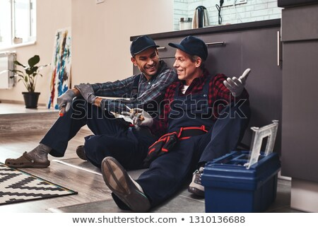 two plumbers resting after work Stock photo © photography33
