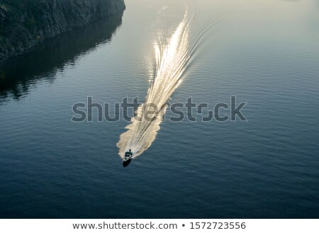 backside of motorized boat with sunset Stock photo © artush