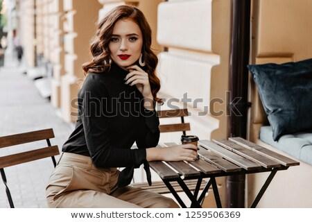 Magnífico gengibre mulher potável copo café Foto stock © photography33