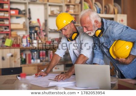 senior craftsman holding a blueprint Stock photo © photography33