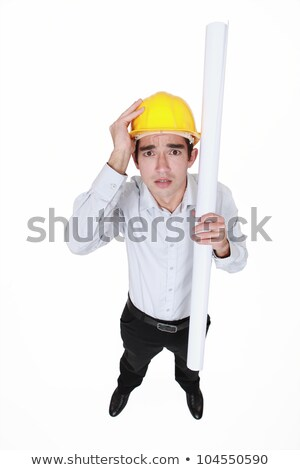 Panicked engineer holding a rolled-up drawing Stock photo © photography33