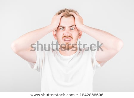 Anxious young businessman against a white background Stock photo © wavebreak_media