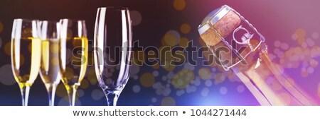Enfocar superior champán botella negro Foto stock © wavebreak_media