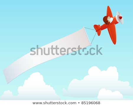 Flying plane with placard Stock photo © zzve