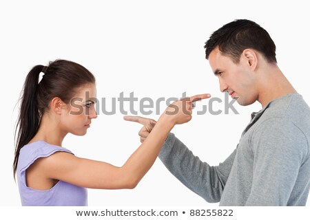 young couple pointing at each other against a white background stock photo © dacasdo