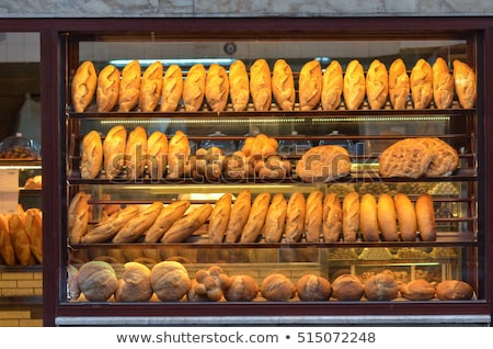 Fresh bread in the display of a bakery Stock photo © Kzenon
