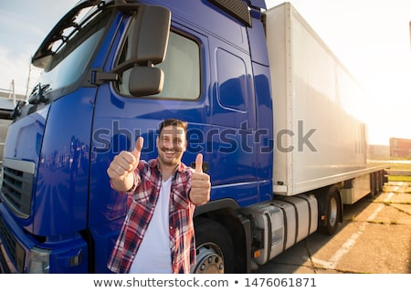 smiling middle aged delivery man stock photo © stockyimages