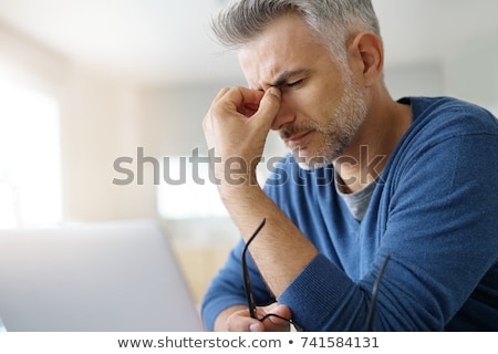 bearded adult man with migraine headache stock photo © stevanovicigor