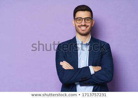 handsome young business man wearing a blue shirt and stock photo © feedough
