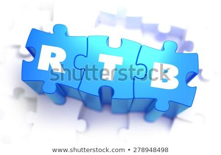 RTB - Text on Blue Puzzles. Stock photo © tashatuvango