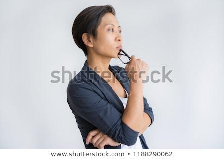 Femme d'affaires pense main menton blanche affaires Photo stock © wavebreak_media