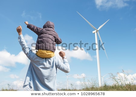 two man with wind turbines stock photo © rastudio