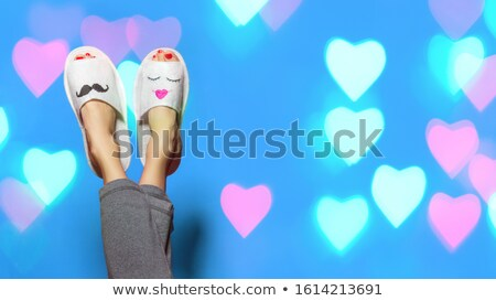 young woman lies by feet upward on the the white Stock photo © Paha_L