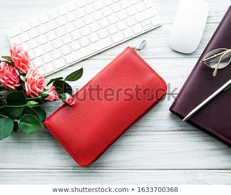 Piros pénztárca és billentyűzet Stock fotó © almaje