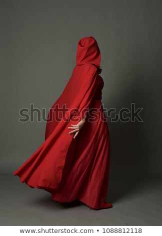Woman in gray dress and red cape Stock photo © filipw