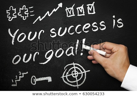 Hand writing on a chalkboard - Achieve your goals Stock photo © Zerbor
