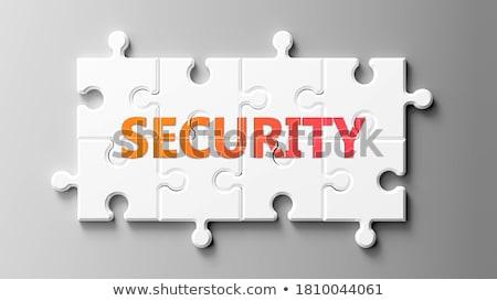 Puzzle parola sicurezza pezzi del puzzle mano costruzione Foto d'archivio © fuzzbones0
