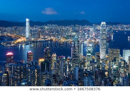 Hongkong éjszaka toronyház épületek út épület Stock fotó © cozyta