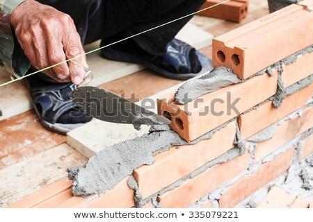 Kőműves fal illusztráció szerszámok munkás téglák Stock fotó © adrenalina