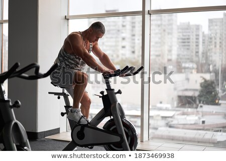 Atletic man sitting near the window Stock photo © deandrobot
