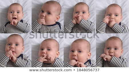 close up of baby sucking his fingers Stock photo © dolgachov