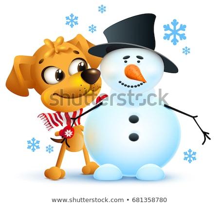 Yellow dog symbol of year 2018. Winter vacation making snowman Stock photo © orensila