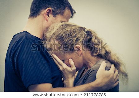 Portrait of a couple - wife hugging her husband Stock photo © majdansky