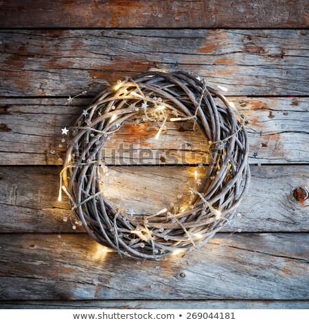 çelenk Noel ışıklar eller güzel Stok fotoğraf © artjazz