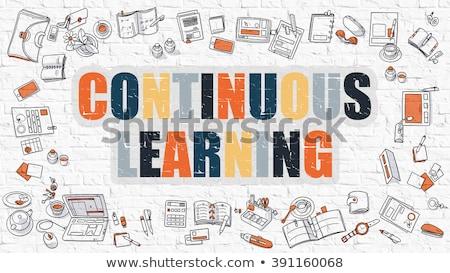 Continuous Learning on the White Brick Wall. Stock photo © tashatuvango